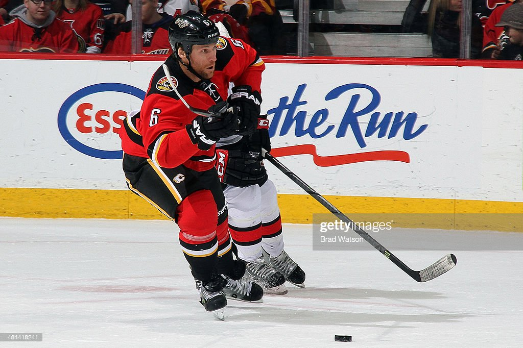 Dennis Wideman #6 of the Calgary Flames skates against the Ottawa Senators at Scotiabank Saddledome on March 5, 2014 in Calgary, Alberta, Canada. The Flames won 4-1.