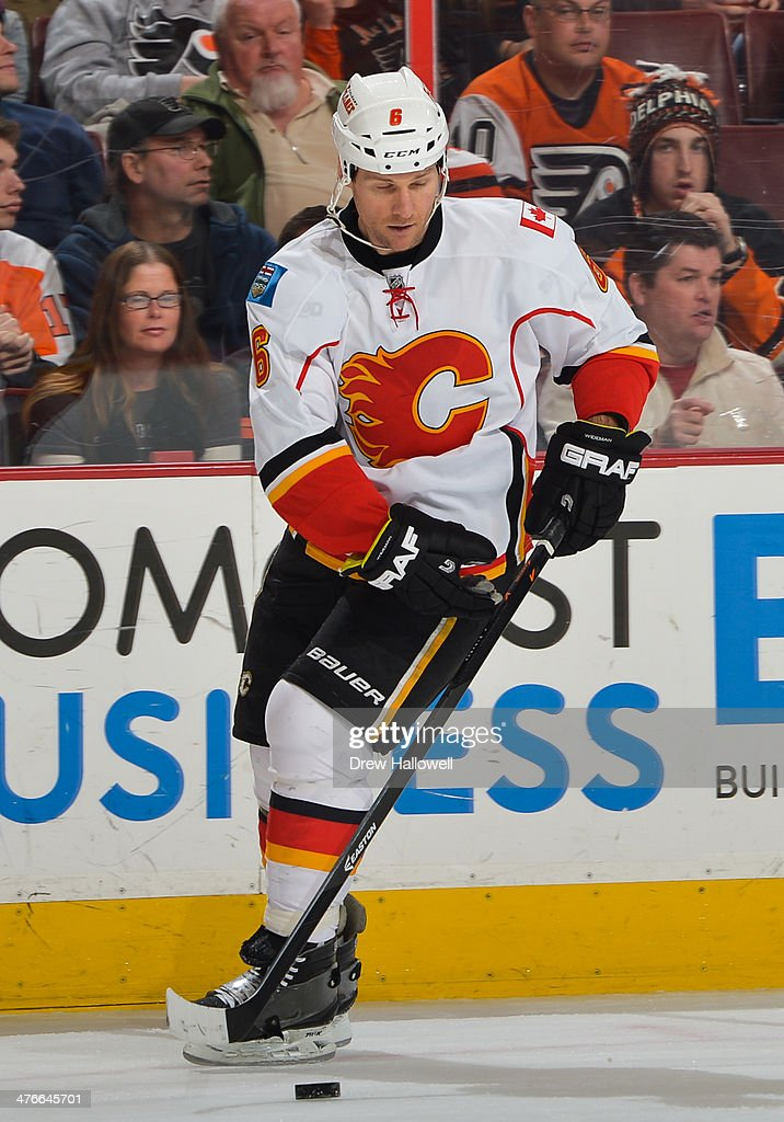 Dennis Wideman #6 of the Calgary Flames skates against the Philadelphia Flyers at the Wells Fargo Center on February 8, 2014 in Philadelphia, Pennsylvania.