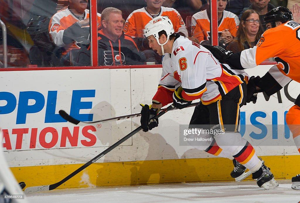 Dennis Wideman #6 of the Calgary Flames skates against the Philadelphia Flyers at the Wells Fargo Center on February 8, 2014 in Philadelphia, Pennsylvania. The Flyers won 2-1.