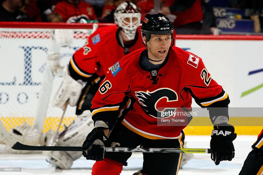 <a gi-track='captionPersonalityLinkClicked' href=/galleries/search?phrase=Dennis+Wideman&family=editorial&specificpeople=575234 ng-click='$event.stopPropagation()'>Dennis Wideman</a> #26 of the Calgary Flames skates against the San Jose Sharks on January 20, 2013 at the Scotiabank Saddledome in Calgary, Alberta, Canada. The Sharks won 4-1.