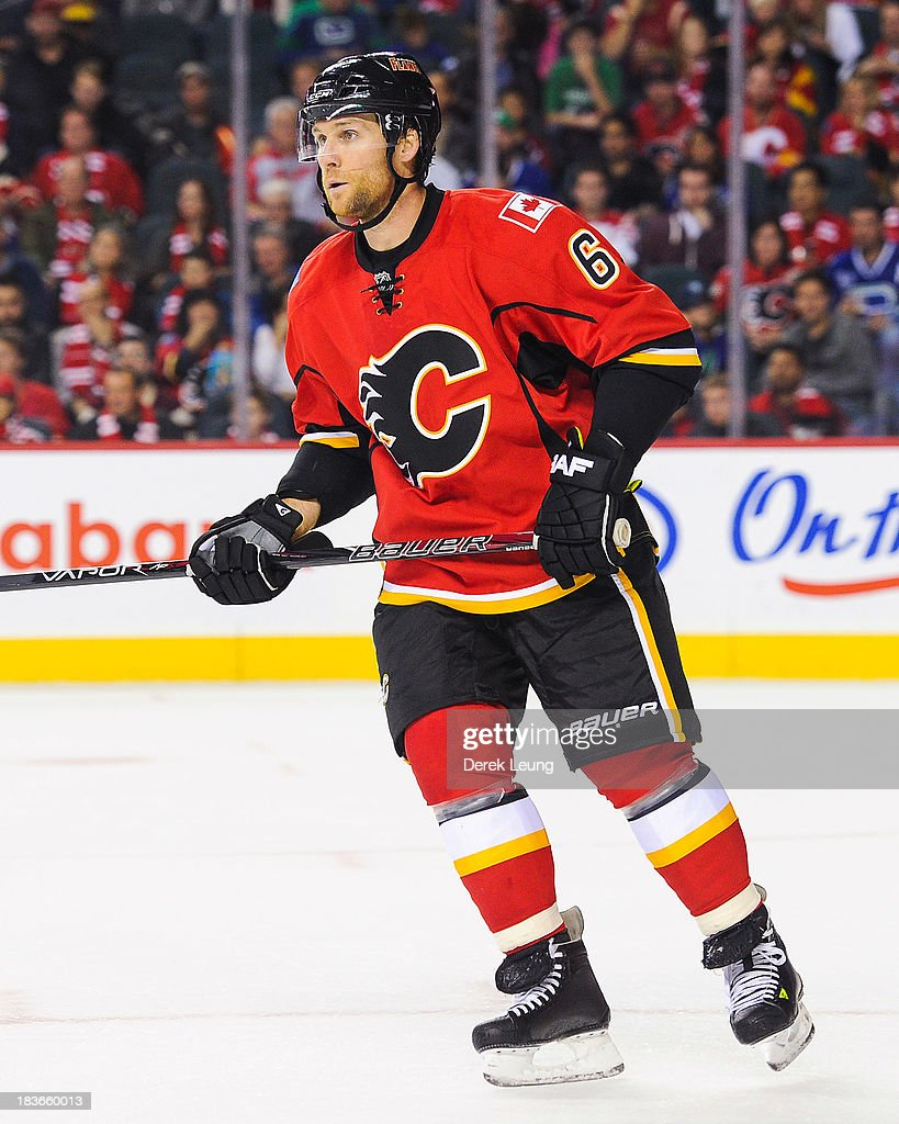 Dennis Wideman #6 of the Calgary Flames skates against the Vancouver Canucks during the Flames' home opening NHL game at Scotiabank Saddledome on October 6, 2013 in Calgary, Alberta, Canada.