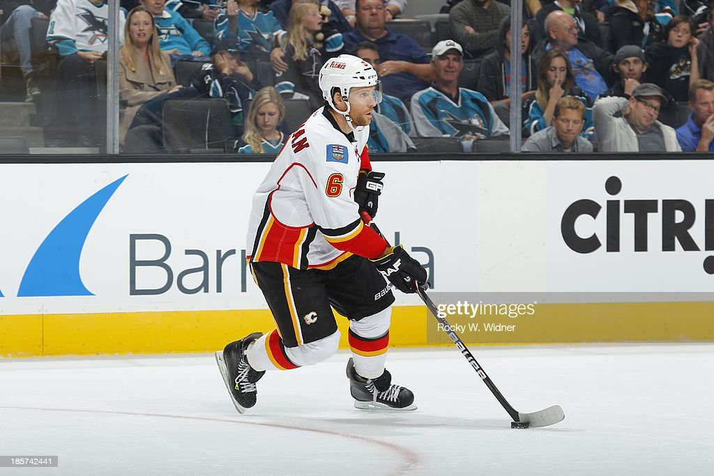 Dennis Wideman #6 of the Calgary Flames skates with control of the puck against the San Jose Sharks at SAP Center on October 19 2013 in San Jose, California.