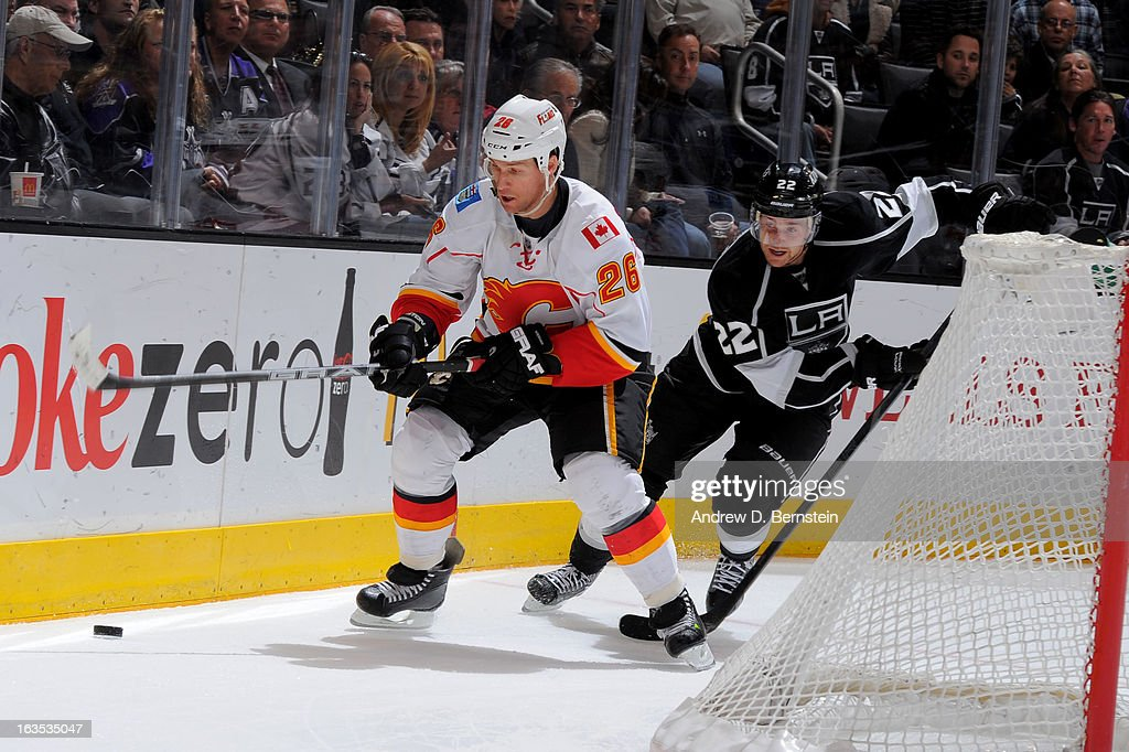 Dennis Wideman #26 of the Calgary Flames skates with the puck against the Los Angeles Kings at Staples Center on March 11, 2013 in Los Angeles, California.