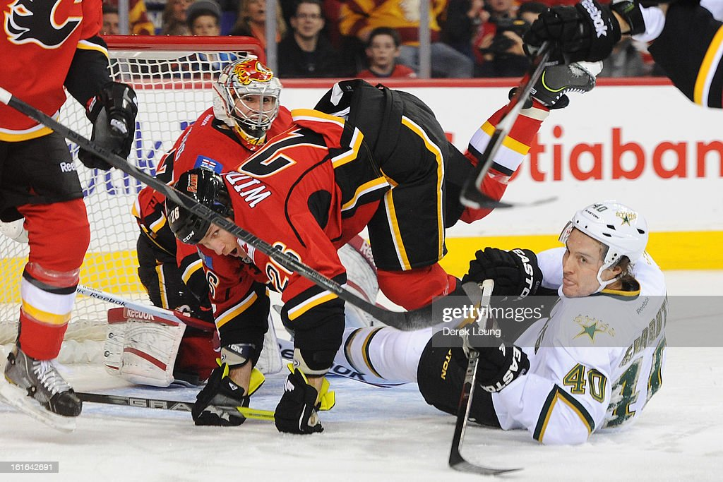 <a gi-track='captionPersonalityLinkClicked' href=/galleries/search?phrase=Dennis+Wideman&family=editorial&specificpeople=575234 ng-click='$event.stopPropagation()'>Dennis Wideman</a> #26 of the Calgary Flames trips over Ryan Garbutt #40 of the Dallas Stars during an NHL game at Scotiabank Saddledome on February 13, 2013 in Calgary, Canada.