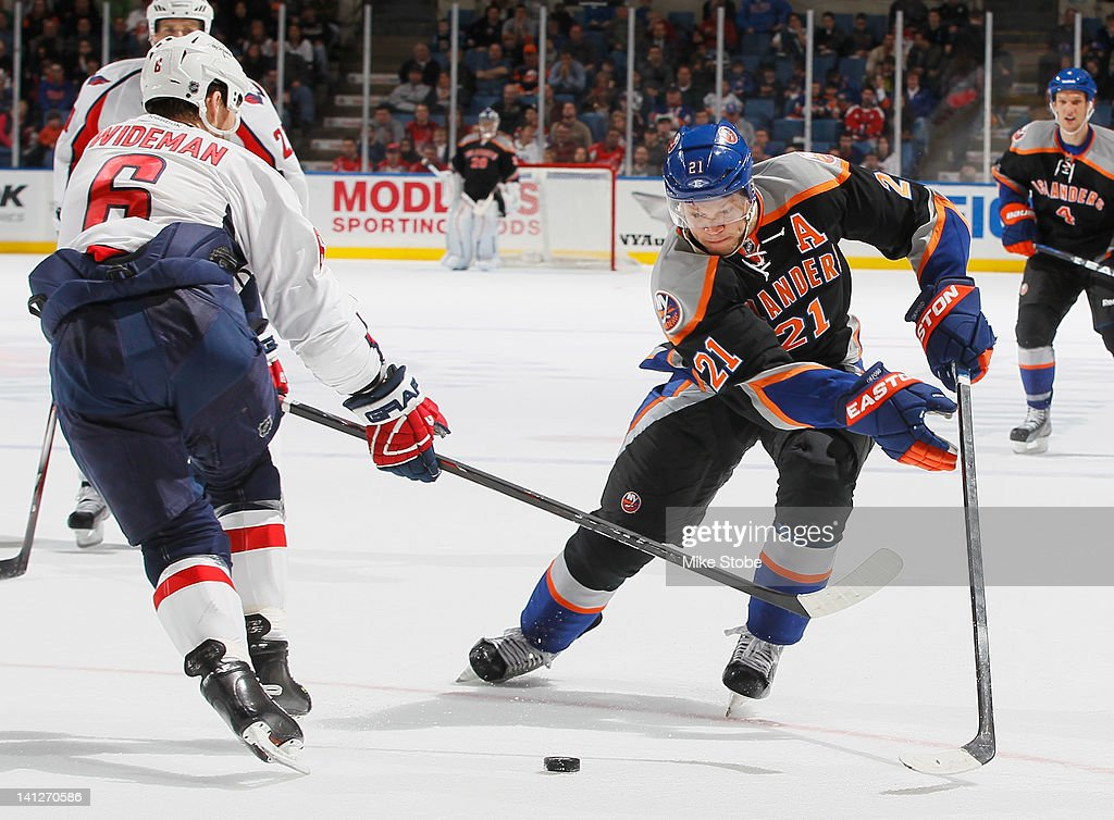<a gi-track='captionPersonalityLinkClicked' href=/galleries/search?phrase=Dennis+Wideman&family=editorial&specificpeople=575234 ng-click='$event.stopPropagation()'>Dennis Wideman</a> #6 of the Washington Capitals and <a gi-track='captionPersonalityLinkClicked' href=/galleries/search?phrase=Kyle+Okposo&family=editorial&specificpeople=540469 ng-click='$event.stopPropagation()'>Kyle Okposo</a> #21 of the New York Islanders battle for the puck at Nassau Veterans Memorial Coliseum on March 13, 2012 in Uniondale, New York. The Capitals defeated the Islanders 5-4 in a shootout.