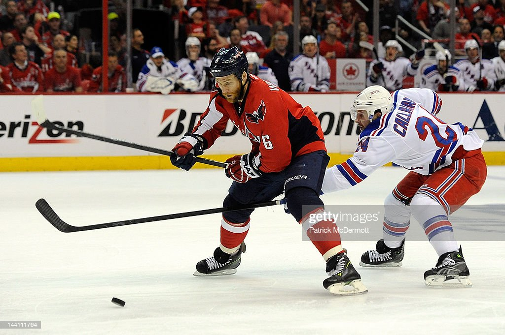 <a gi-track='captionPersonalityLinkClicked' href=/galleries/search?phrase=Dennis+Wideman&family=editorial&specificpeople=575234 ng-click='$event.stopPropagation()'>Dennis Wideman</a> #6 of the Washington Capitals and <a gi-track='captionPersonalityLinkClicked' href=/galleries/search?phrase=Ryan+Callahan&family=editorial&specificpeople=809690 ng-click='$event.stopPropagation()'>Ryan Callahan</a> #24 of the New York Rangers battle for the puck in second period of Game Six of the Eastern Conference Semifinals during the 2012 NHL Stanley Cup Playoffs at Verizon Center on May 9, 2012 in Washington, DC. Callahan was called for a minor penalty for tripping Wideman.