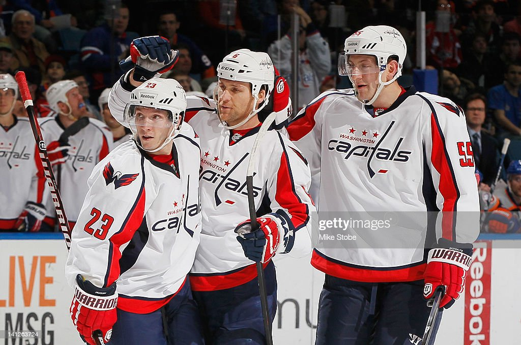 Dennis Wideman of the Washington Capitals is congratulated on his second period goal by teammates Keith Aucoin and Jeff Schultz during the game...