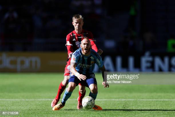 Dennis Widgren of Ostersunds FK and Magnus Eriksson of Djurgardens IF competes for the ball during the Allsvenskan match between Djurgardens IF and...