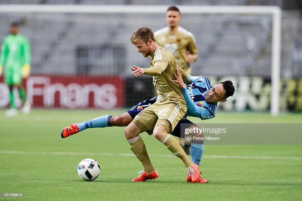 Dennis Widgren of Ostersunds FK and Seon-Min Moon of Djurgardens IF competes for the ball during the Allsvenskan match between Djurgardens IF and Ostersunds FK at Tele2 Arena on May 2, 2016 in Stockholm, Sweden.