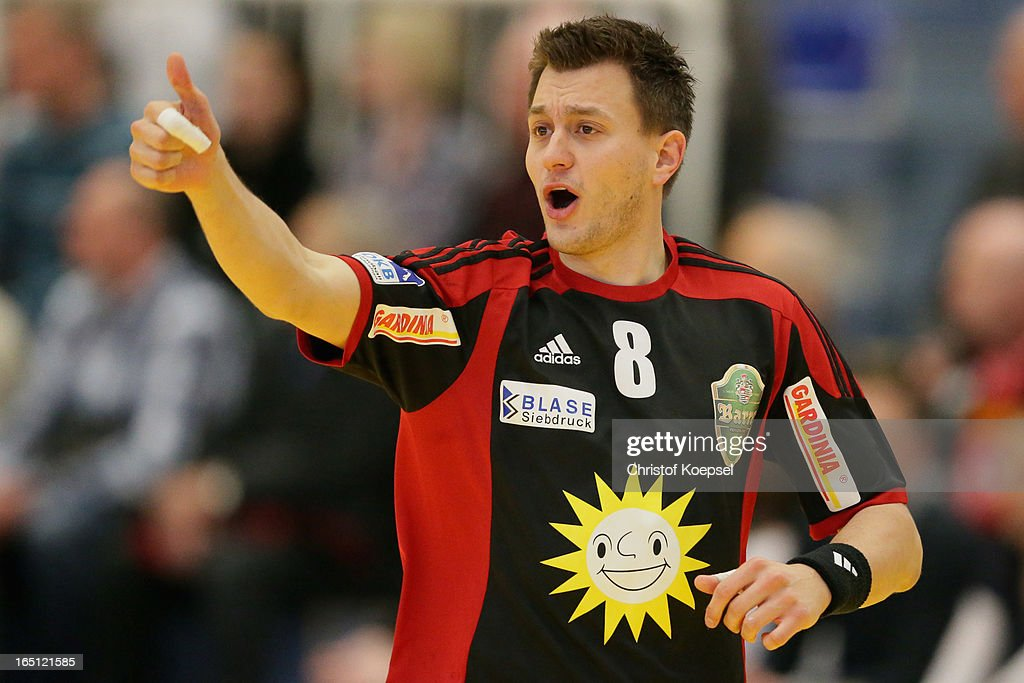 Dennis Wilke of Tus N-Luebbecke celebrates a goal during the DKB Handball Bundesliga match between TUSEM Essen and Tus N-Luebbecke at the Sportpark Am Hallo on March 31, 2013 in Essen, Germany.