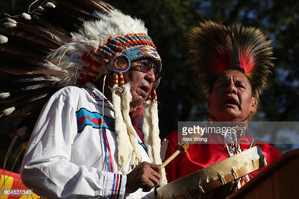 Dennis Zotigh and his father Ralph Zotigh of the Kiowa Dakota and Pueblo Tribes sing during a rally against the Dakota Access Pipeline September 13...