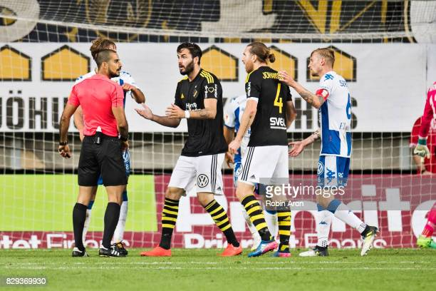 Denny Avdic and NilsEric Johansson of AIK upset and talking to referee Mohammed AlHakim after the disallowed goal during the Allsvenskan match...