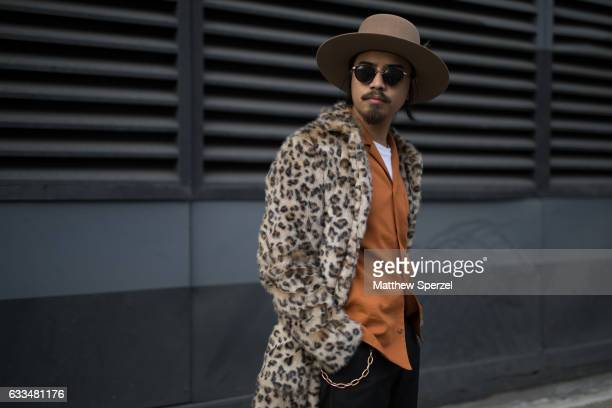 Denny Balmaceda is seen attending Nautica/Matiere/Rochambeau wearing a Deveaux shirt a Stetson hat and Topman coat on February 1 2017 in New York City