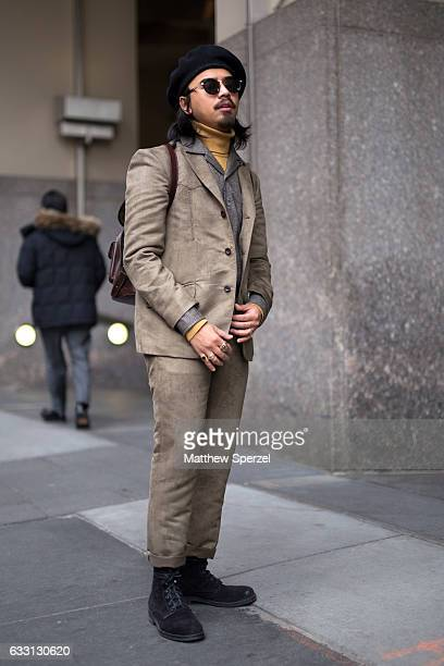 Denny Balmaceda is seen attending New York Mens Day at Dune Studios wearing a Kramer Stoudt suit on January 30 2017 in New York City