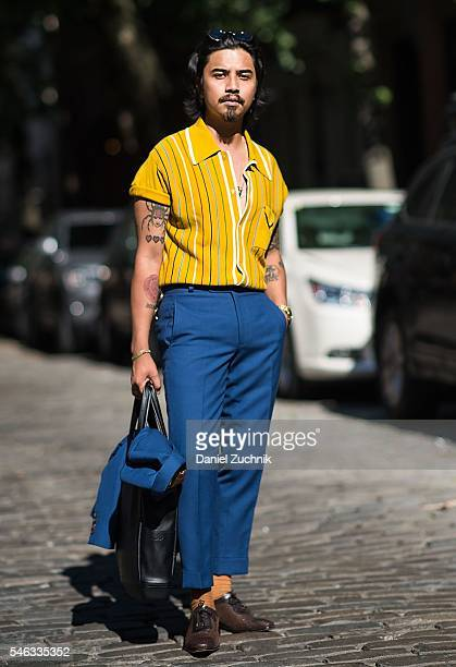 Denny Balmaceda is seen outside the Krammer Stoudt show wearing a vintage shirt Darkoh Menswear blue suit Paul Drish shoes Hook and Albert socks and...