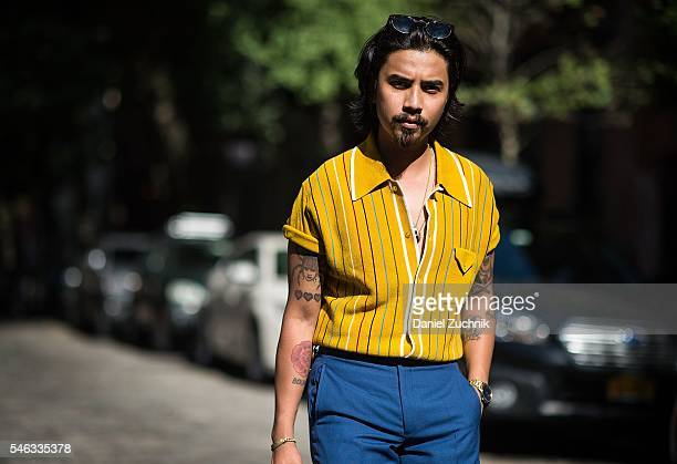 Denny Balmaceda is seen outside the Krammer Stoudt show wearing a vintage shirt Darkoh Menswear blue suit and vintage sunglasses during New York...