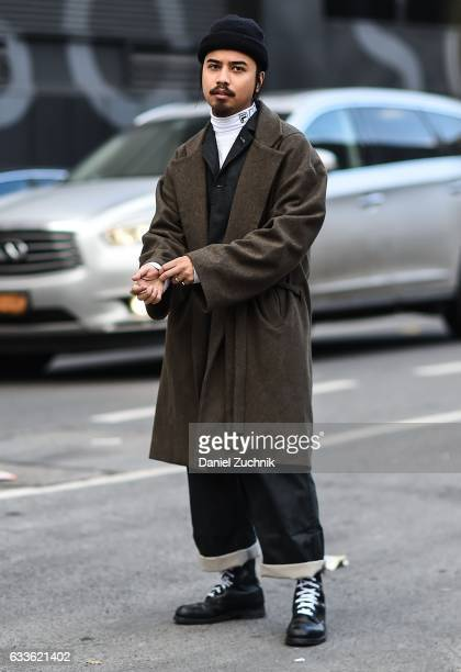 Denny Balmaceda is seen wearing a NDG brown coat outside of the STAMPD show during New York Fashion Week Men's AW17 on February 2 2017 in New York...