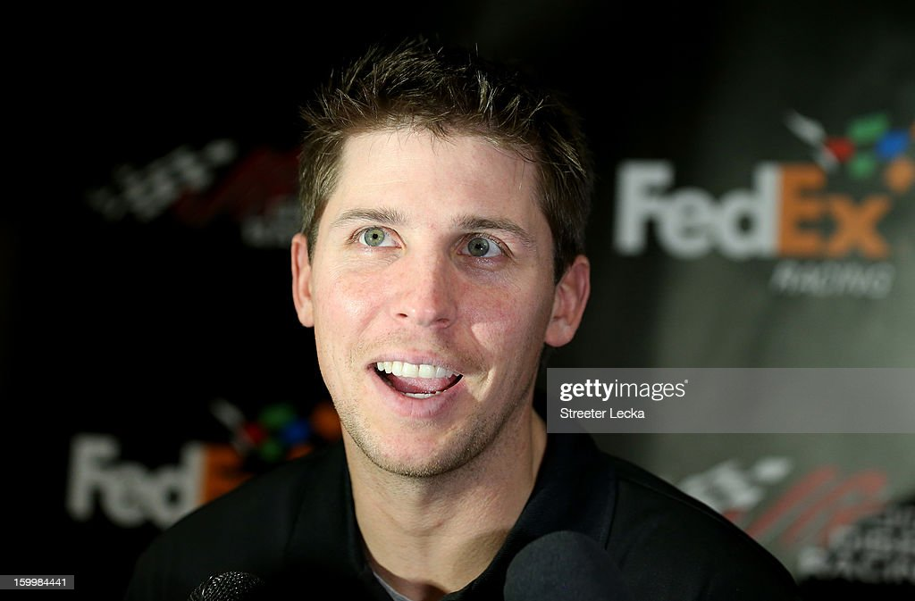 <a gi-track='captionPersonalityLinkClicked' href=/galleries/search?phrase=Denny+Hamlin&family=editorial&specificpeople=504674 ng-click='$event.stopPropagation()'>Denny Hamlin</a>, driver for Joe Gibbs Racing, speaks to the media during the 2013 NASCAR Sprint Media Tour on January 24, 2013 in Concord, North Carolina.