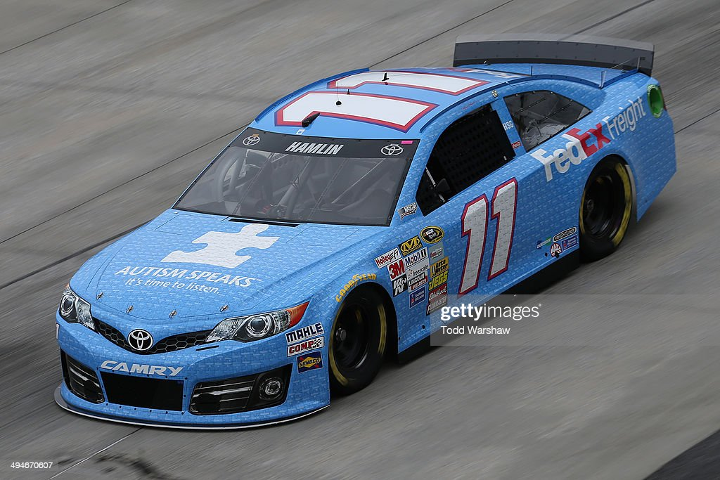 Denny Hamlin, driver of the #11 Autism Speaks/FedEx Freight Toyota, practices for the NASCAR Sprint Cup Series FedEx 400 Benefiting Autism Speaks at Dover International Speedway on May 30, 2014 in Dover, Delaware.