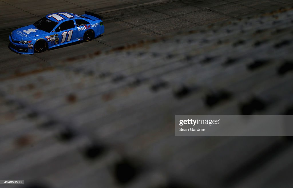 Denny Hamlin, driver of the #11 Autism Speaks/FedEx Freight Toyota, practices for the NASCAR Sprint Cup Series FedEx 400 Benefiting Autism Speaks at Dover International Speedway on May 31, 2014 in Dover, Delaware.