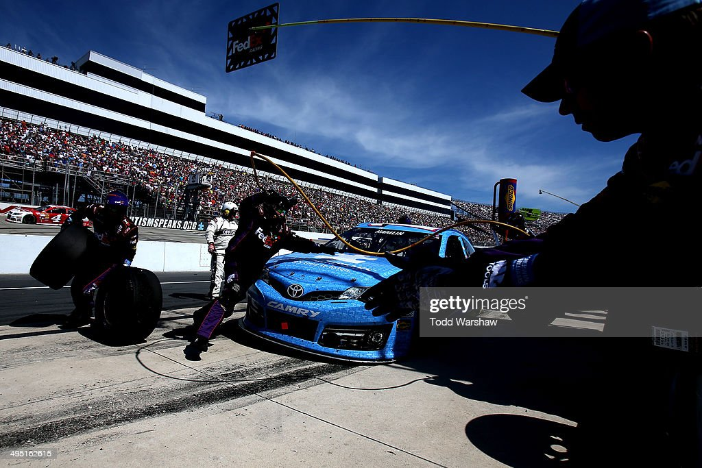 Denny Hamlin, driver of the #11 Autism Speaks/FedEx Freight Toyota, pits during the NASCAR Sprint Cup Series FedEx 400 Benefiting Autism Speaks at Dover International Speedway on June 1, 2014 in Dover, Delaware.