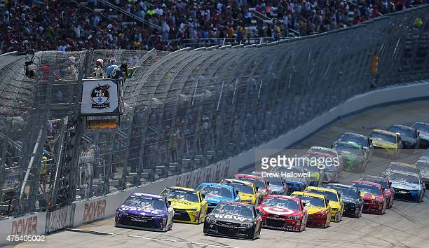 Denny Hamlin driver of the FedEx Cares Toyota and Martin Truex Jr driver of the Furniture Row/Visser Precision Chevrolet lead the field to start the...