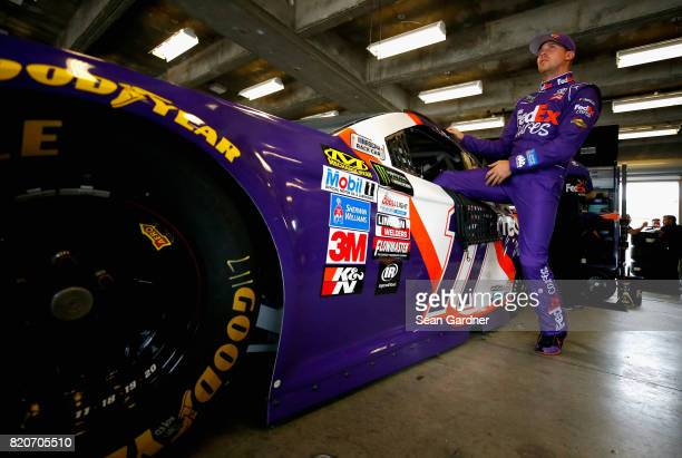 Denny Hamlin driver of the FedEx Cares Toyota climbs into his car during practice for the Monster Energy NASCAR Cup Series Brickyard 400 at...
