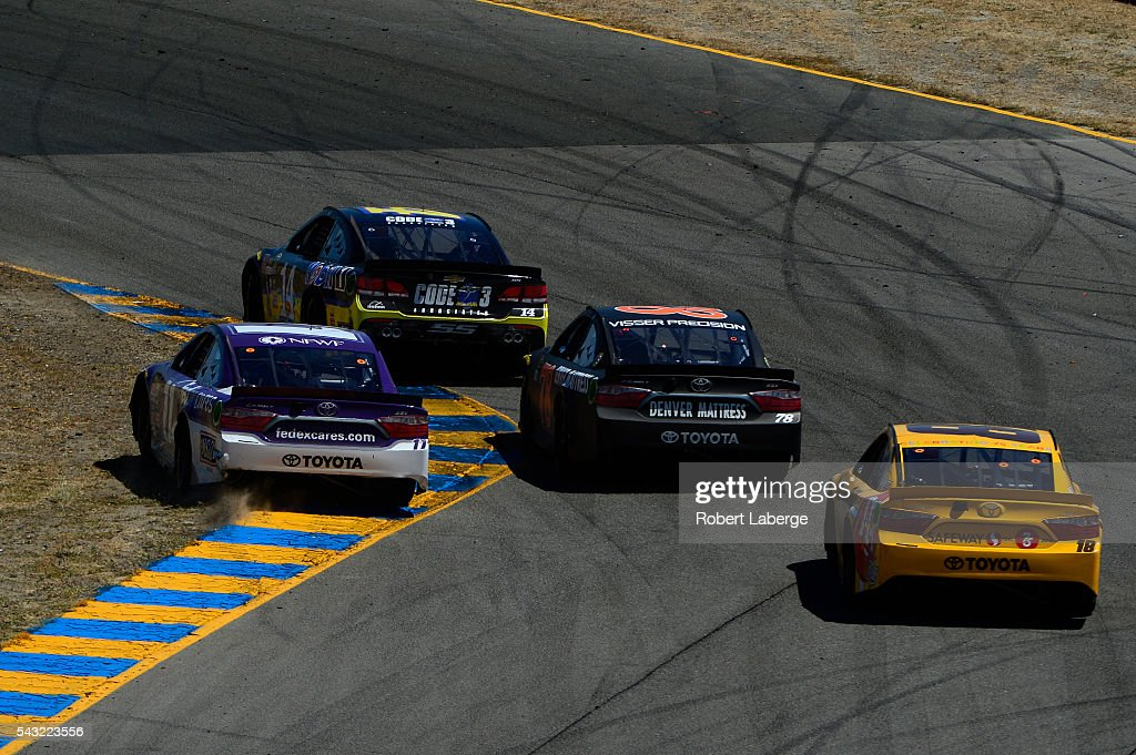 <a gi-track='captionPersonalityLinkClicked' href=/galleries/search?phrase=Denny+Hamlin&family=editorial&specificpeople=504674 ng-click='$event.stopPropagation()'>Denny Hamlin</a>, driver of the #11 FedEx Cares Toyota, cuts the corner of the racetrack during the NASCAR Sprint Cup Series Toyota/Save Mart 350 at Sonoma Raceway on June 26, 2016 in Sonoma, California.