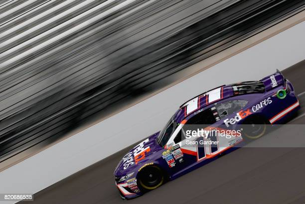 Denny Hamlin driver of the FedEx Cares Toyota drives during practice for the Monster Energy NASCAR Cup Series Brickyard 400 at Indianapolis...