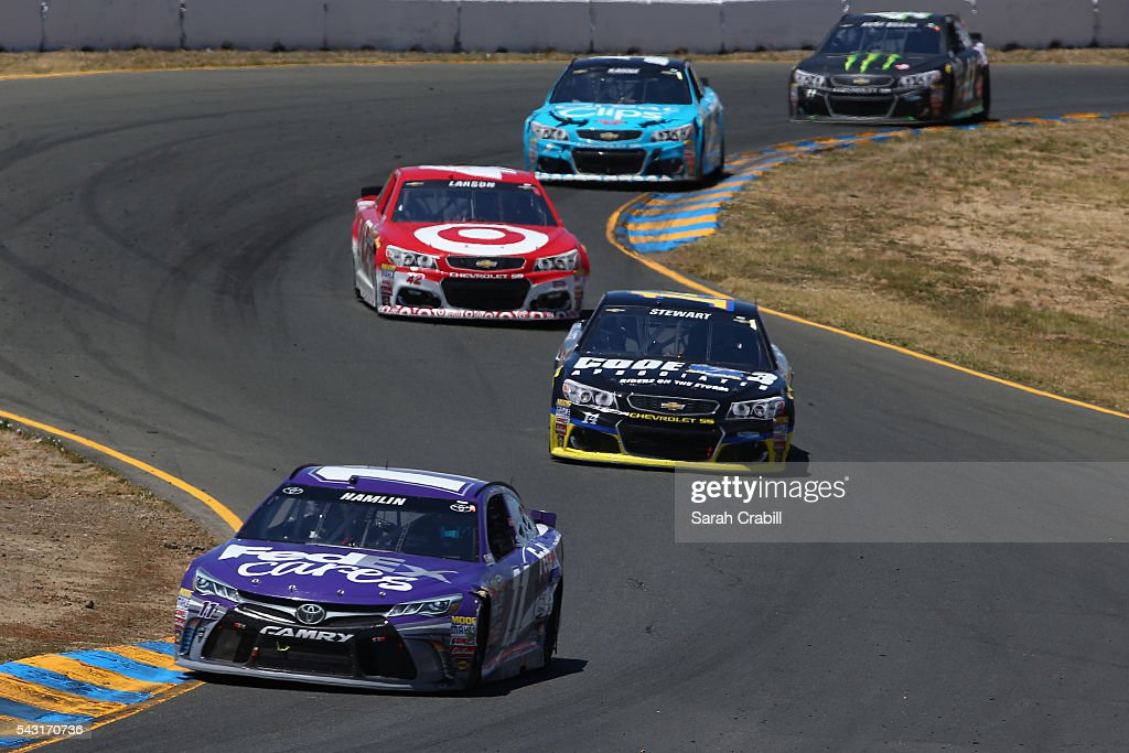 <a gi-track='captionPersonalityLinkClicked' href=/galleries/search?phrase=Denny+Hamlin&family=editorial&specificpeople=504674 ng-click='$event.stopPropagation()'>Denny Hamlin</a>, driver of the #11 FedEx Cares Toyota, leads a pack of cars during the NASCAR Sprint Cup Series Toyota/Save Mart 350 at Sonoma Raceway on June 26, 2016 in Sonoma, California.