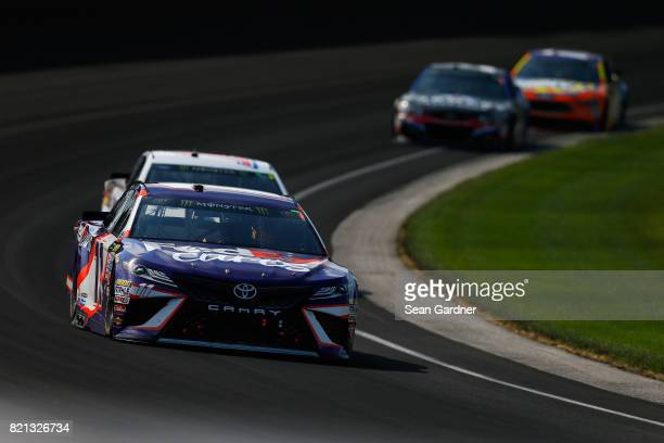 Denny Hamlin driver of the FedEx Cares Toyota leads a pack of cars during the Monster Energy NASCAR Cup Series Brickyard 400 at Indianapolis...