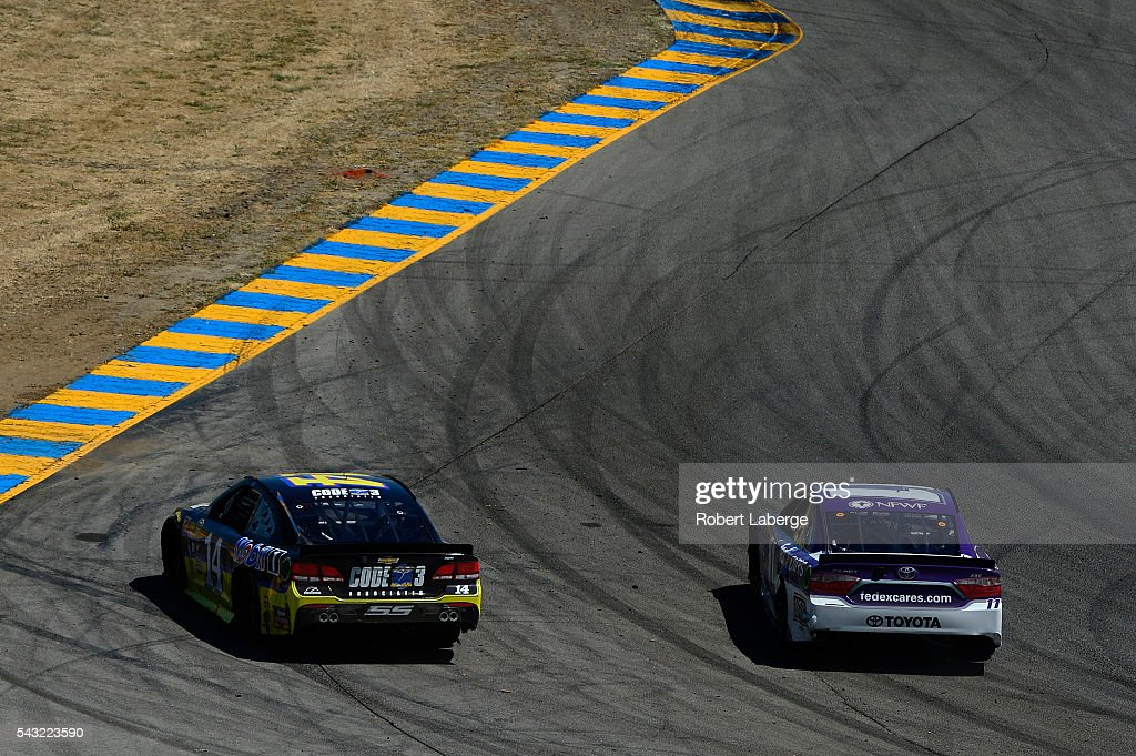 <a gi-track='captionPersonalityLinkClicked' href=/galleries/search?phrase=Denny+Hamlin&family=editorial&specificpeople=504674 ng-click='$event.stopPropagation()'>Denny Hamlin</a>, driver of the #11 FedEx Cares Toyota, passes <a gi-track='captionPersonalityLinkClicked' href=/galleries/search?phrase=Tony+Stewart+-+Race+Car+Driver&family=editorial&specificpeople=201686 ng-click='$event.stopPropagation()'>Tony Stewart</a>, driver of the #14 Code 3 Assoc/Mobil 1 Chevrolet, during the NASCAR Sprint Cup Series Toyota/Save Mart 350 at Sonoma Raceway on June 26, 2016 in Sonoma, California.