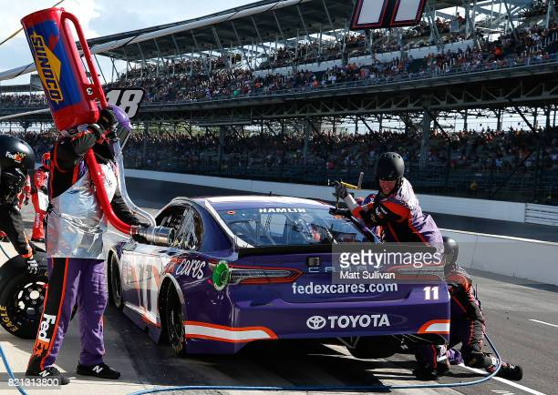 Denny Hamlin driver of the FedEx Cares Toyota pits during the Monster Energy NASCAR Cup Series Brickyard 400 at Indianapolis Motorspeedway on July 23...