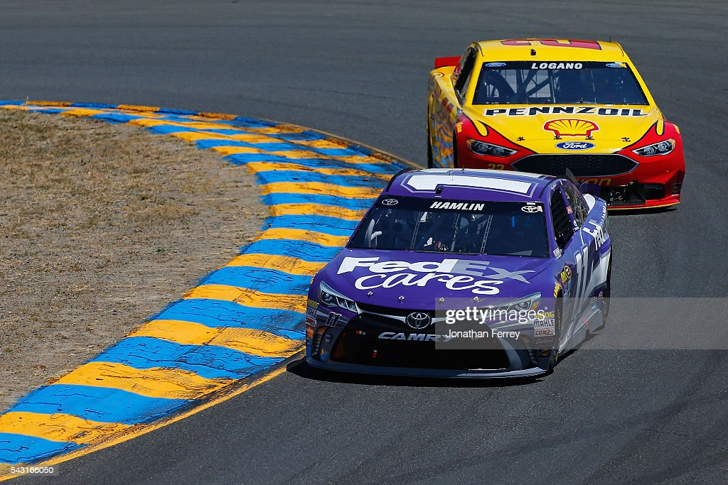 <a gi-track='captionPersonalityLinkClicked' href=/galleries/search?phrase=Denny+Hamlin&family=editorial&specificpeople=504674 ng-click='$event.stopPropagation()'>Denny Hamlin</a>, driver of the #11 FedEx Cares Toyota, races <a gi-track='captionPersonalityLinkClicked' href=/galleries/search?phrase=Joey+Logano&family=editorial&specificpeople=4510426 ng-click='$event.stopPropagation()'>Joey Logano</a>, driver of the #22 Shell Pennzoil Ford, during the NASCAR Sprint Cup Series Toyota/Save Mart 350 at Sonoma Raceway on June 26, 2016 in Sonoma, California.