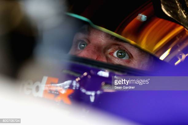 Denny Hamlin driver of the FedEx Cares Toyota sits in his car during practice for the Monster Energy NASCAR Cup Series Brickyard 400 at Indianapolis...