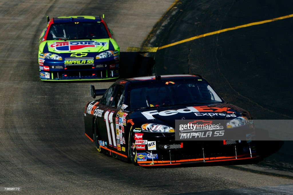 Denny Hamlin driver of the FedEx Express Chevrolet leads Kyle Busch driver of the Carquest Chevrolet during the NASCAR Nextel Cup Series Food City...
