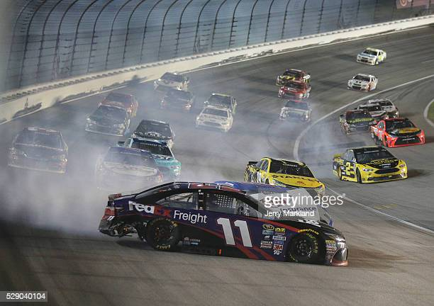 Denny Hamlin driver of the FedEx Express Freight Toyota and Brad Keselowski driver of the Alliance Truck Parts Ford wreck during the NASCAR Sprint...