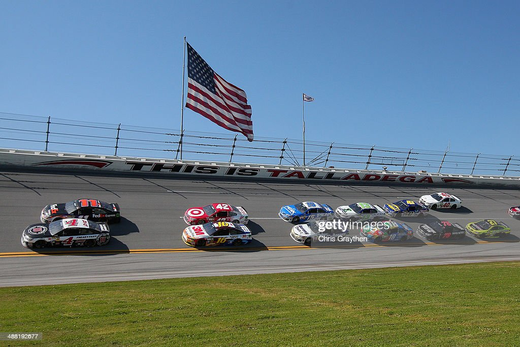 Denny Hamlin, driver of the #11 FedEx Express Toyota, and Kevin Harvick, driver of the #4 Jimmy John's Chevrolet, lead the field during the NASCAR Sprint Cup Series Aaron's 499 at Talladega Superspeedway on May 4, 2014 in Talladega, Alabama.