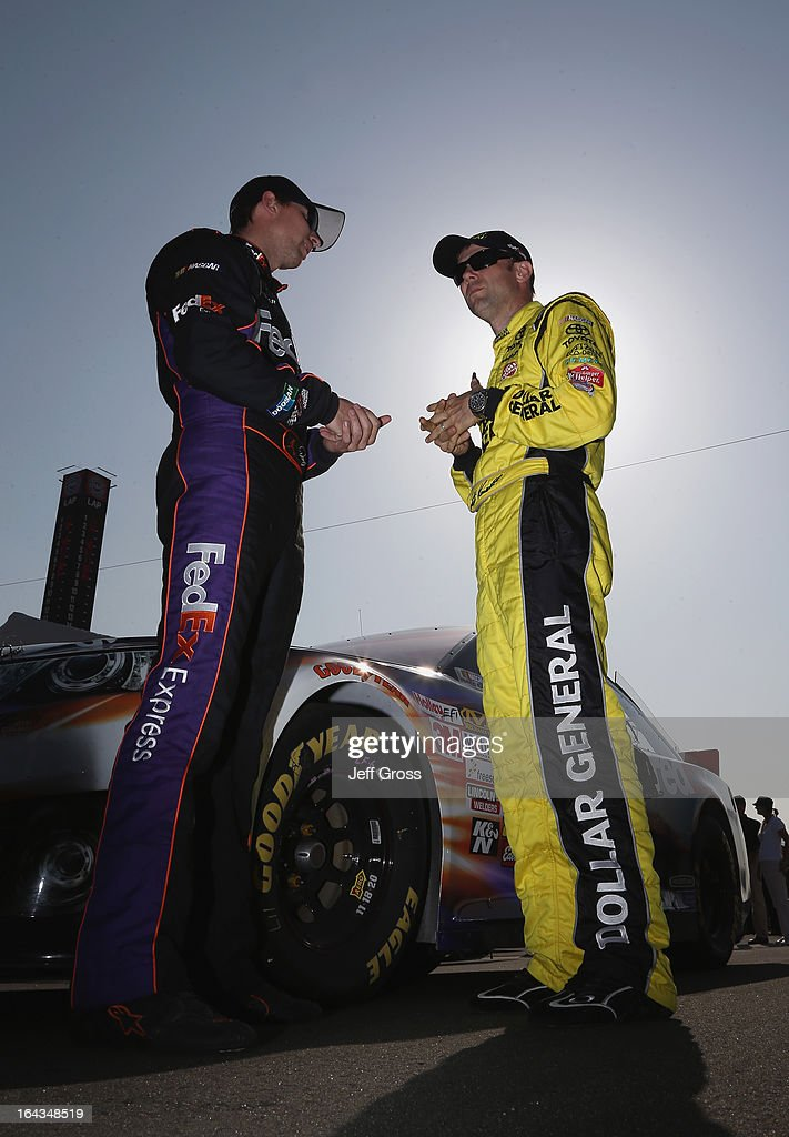 <a gi-track='captionPersonalityLinkClicked' href=/galleries/search?phrase=Denny+Hamlin&family=editorial&specificpeople=504674 ng-click='$event.stopPropagation()'>Denny Hamlin</a>, driver of the #11 FedEx Express Toyota, and <a gi-track='captionPersonalityLinkClicked' href=/galleries/search?phrase=Matt+Kenseth&family=editorial&specificpeople=204192 ng-click='$event.stopPropagation()'>Matt Kenseth</a>, driver of the #20 Dollar General Toyota, talk on the grid during qualifying for the NASCAR Sprint Cup Series Auto Club 400 at Auto Club Speedway on March 22, 2013 in Fontana, California.
