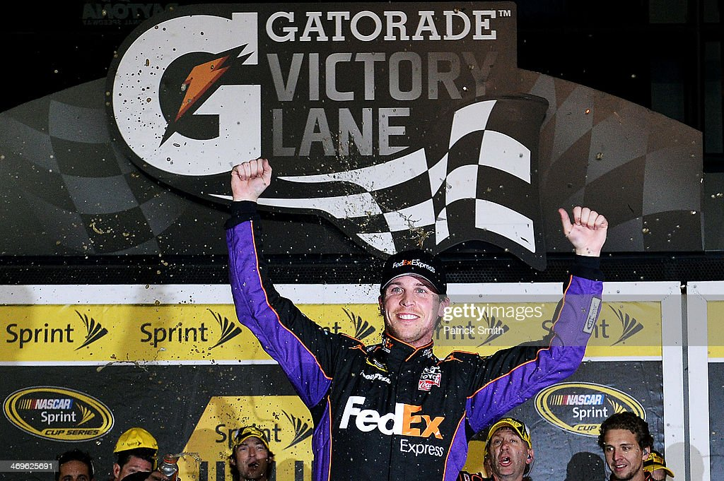 <a gi-track='captionPersonalityLinkClicked' href=/galleries/search?phrase=Denny+Hamlin&family=editorial&specificpeople=504674 ng-click='$event.stopPropagation()'>Denny Hamlin</a>, driver of the #11 FedEx Express Toyota, celebrates in victory lane after winning the NASCAR Sprint Cup Series Sprint Unlimited at Daytona International Speedway on February 15, 2014 in Daytona Beach, Florida.
