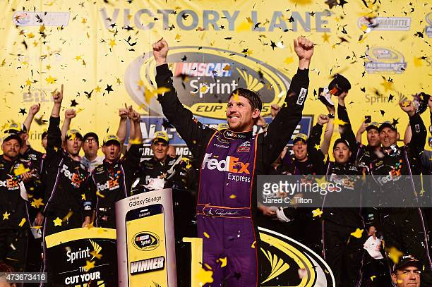 Denny Hamlin driver of the FedEx Express Toyota celebrates in victory lane after winning the NASCAR Sprint Cup Series Sprint AllStar Race at...