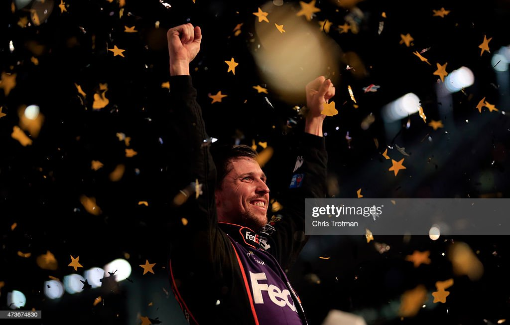 Denny Hamlin, driver of the #11 FedEx Express Toyota, celebrates in victory lane after winning the NASCAR Sprint Cup Series Sprint All-Star Race at Charlotte Motor Speedway on May 16, 2015 in Charlotte, North Carolina.