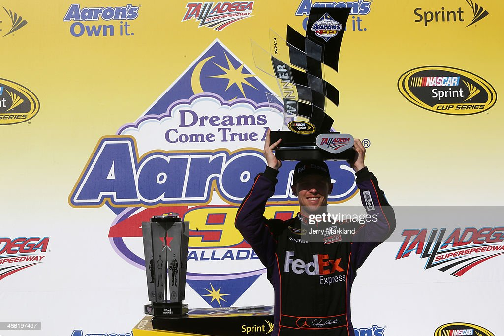 Denny Hamlin, driver of the #11 FedEx Express Toyota, celebrates in Victory Lane after winning the NASCAR Sprint Cup Series Aaron's 499 at Talladega Superspeedway on May 4, 2014 in Talladega, Alabama.