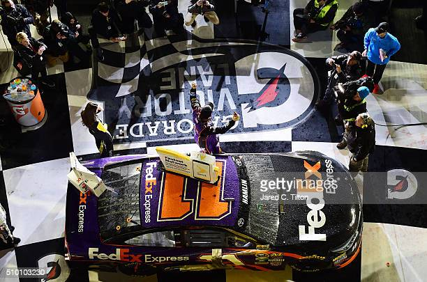 Denny Hamlin driver of the FedEx Express Toyota celebrates in Victory Lane after winning the NASCAR Sprint Cup Series Sprint Unlimited at Daytona...