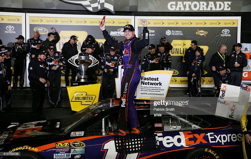 <a gi-track='captionPersonalityLinkClicked' href=/galleries/search?phrase=Denny+Hamlin&family=editorial&specificpeople=504674 ng-click='$event.stopPropagation()'>Denny Hamlin</a>, driver of the #11 FedEx Express Toyota, celebrates in Victory Lane after winning the NASCAR Sprint Cup Series Sprint Unlimited at Daytona International Speedway on February 13, 2016 in Daytona Beach, Florida.