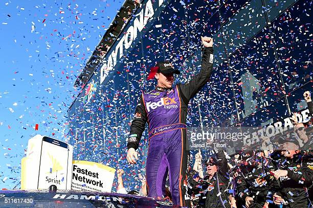 Denny Hamlin driver of the FedEx Express Toyota celebrates in Victory Lane after winning the NASCAR Sprint Cup Series DAYTONA 500 at Daytona...