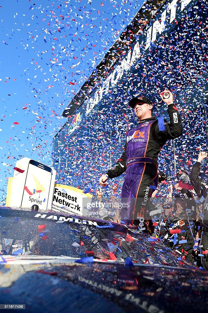 <a gi-track='captionPersonalityLinkClicked' href=/galleries/search?phrase=Denny+Hamlin&family=editorial&specificpeople=504674 ng-click='$event.stopPropagation()'>Denny Hamlin</a>, driver of the #11 FedEx Express Toyota, celebrates in Victory Lane after winning the NASCAR Sprint Cup Series DAYTONA 500 at Daytona International Speedway on February 21, 2016 in Daytona Beach, Florida.