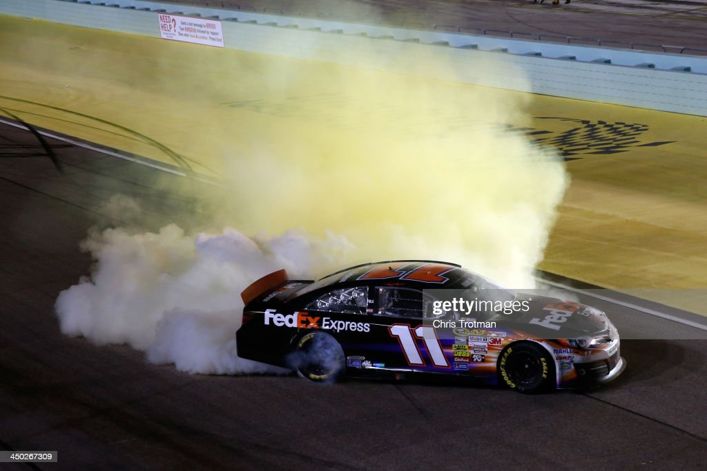 <a gi-track='captionPersonalityLinkClicked' href=/galleries/search?phrase=Denny+Hamlin&family=editorial&specificpeople=504674 ng-click='$event.stopPropagation()'>Denny Hamlin</a>, driver of the #11 FedEx Express Toyota, celebrates with a burnout after winning the NASCAR Sprint Cup Series Ford EcoBoost 400 at Homestead-Miami Speedway on November 17, 2013 in Homestead, Florida.