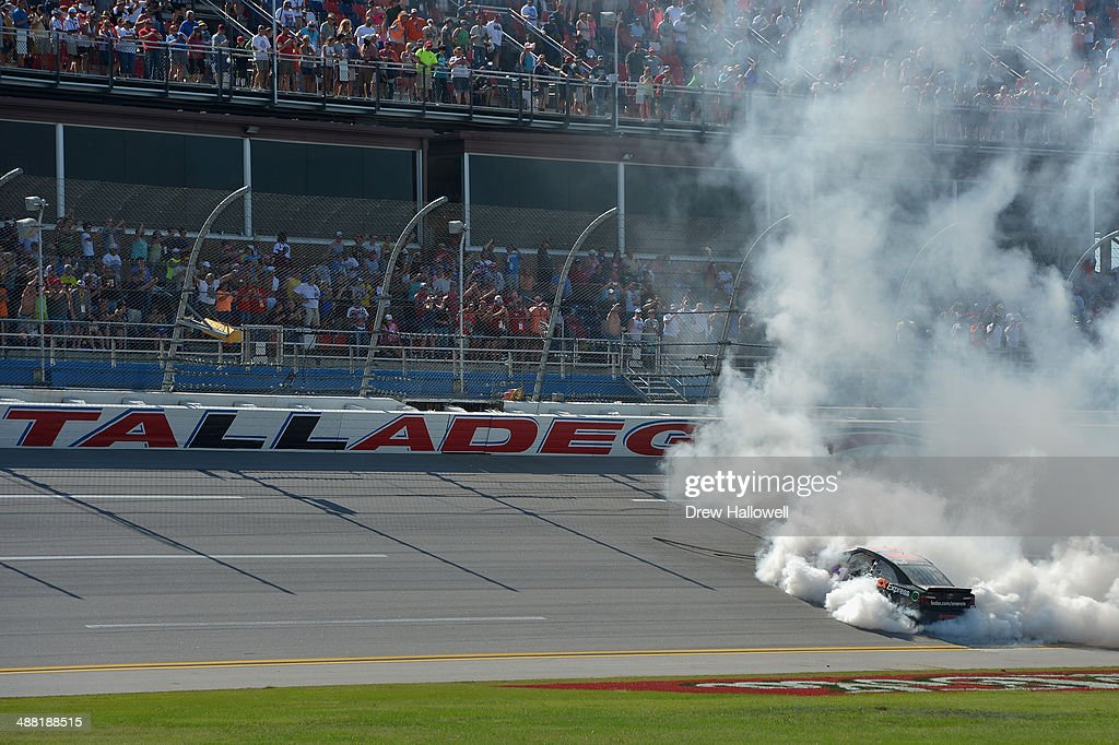 Denny Hamlin, driver of the #11 FedEx Express Toyota, celebrates with a burnout after winning the NASCAR Sprint Cup Series Aaron's 499 at Talladega Superspeedway on May 4, 2014 in Talladega, Alabama.