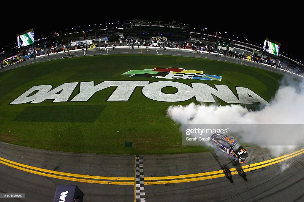 Denny Hamlin, driver of the #11 FedEx Express Toyota, celebrates with a burnout after winning the NASCAR Sprint Cup Series Sprint Unlimited at Daytona International Speedway on February 13, 2016 in Daytona Beach, Florida.